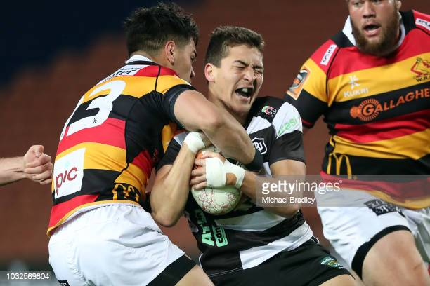 Hawkes Bay's Tiaan Falcon is tackled by Waikato's Quinn Tupaea during the round five Mitre 10 Cup match between Waikato and Hawke's Bay on September...