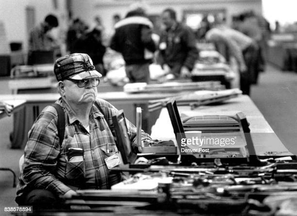 E Hawkinson a cooector of Antique and Modern Firearms is at one of the many tables piled high with guns of all sizes and shapes This is the Annual...