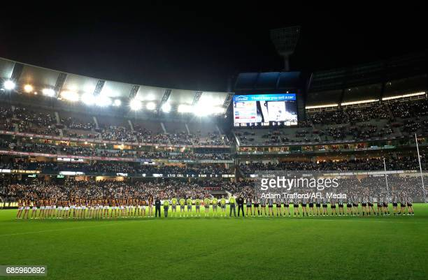 Hawks and Magpies players line up together for a tribute to Lou Richards during the 2017 AFL round 09 match between the Collingwood Magpies and the...