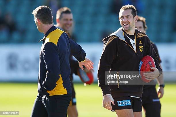 Hawks Captain Luke Hodge reacts to Eagles coach Adam Simpson during the round 12 AFL match between the Hawthorn Hawks and the West Coast Eagles at...