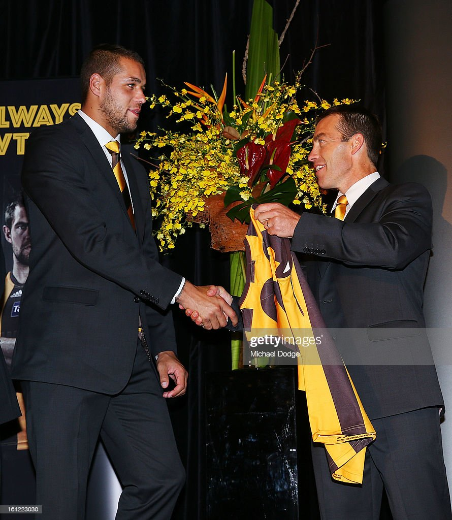 Hawks coach Alastair Clarkson presents Lance Franklin his jumper on stage during the Hawthorn Hawks Season Launch and Hall of Fame presentation at Encore St Kilda on March 21, 2013 in Melbourne, Australia.
