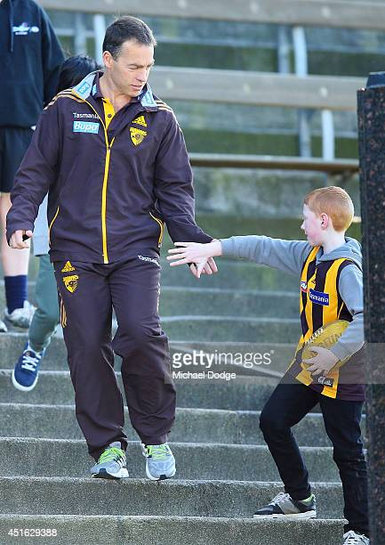 Hawks coach Alastair Clarkson, recovering from serious illness, is welcomed back by a fan during a Hawthorn Hawks AFL training session at Waverley...