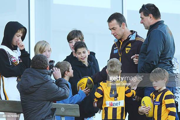 Hawks coach Alastair Clarkson, recovering from serious illness, is welcomed back by fans during a Hawthorn Hawks AFL training session at Waverley...