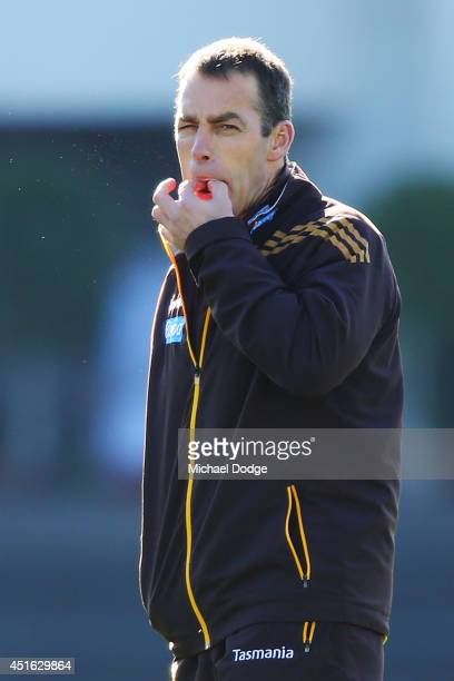 Hawks coach Alastair Clarkson, recovering from serious illness, whistles loudly for the players to finish a Hawthorn Hawks AFL training session at...