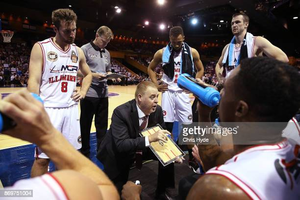Hawks coach Rob Beveridge talks to players during the round five NBL match between the Brisbane Bullets and the Illawarra Hawks at Brisbane...