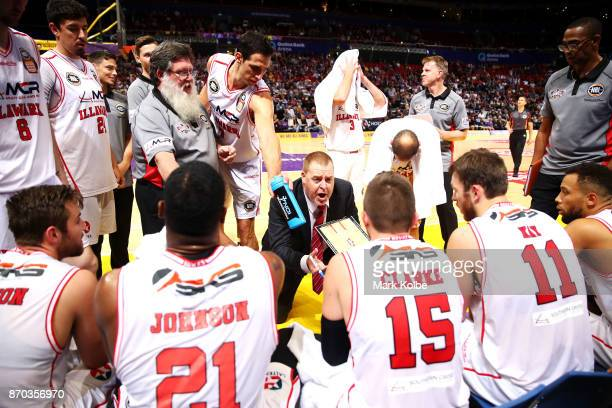 Hawks coach Rob Beveridge talks to players during the round five NBL match between the Sydney Kings and the Illawarra Hawks at Qudos Bank Arena on...