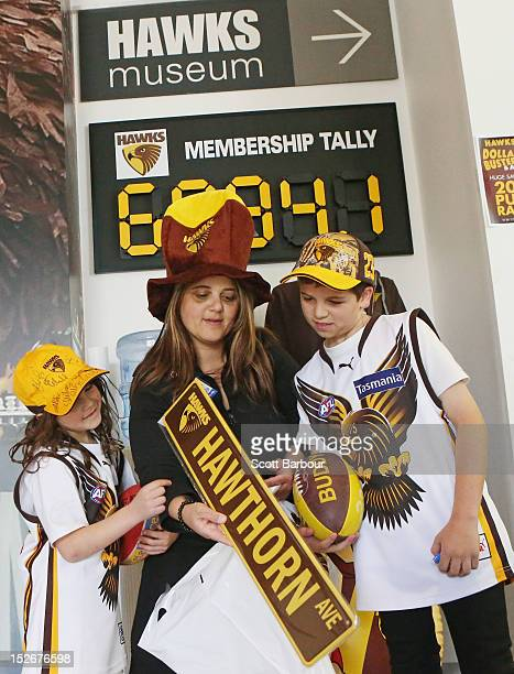 Hawks fans inspect their purchases as they leave the HawksNest the clubs merchandise store at Waverley Park during AFL Grand Final Week in Melbourne...