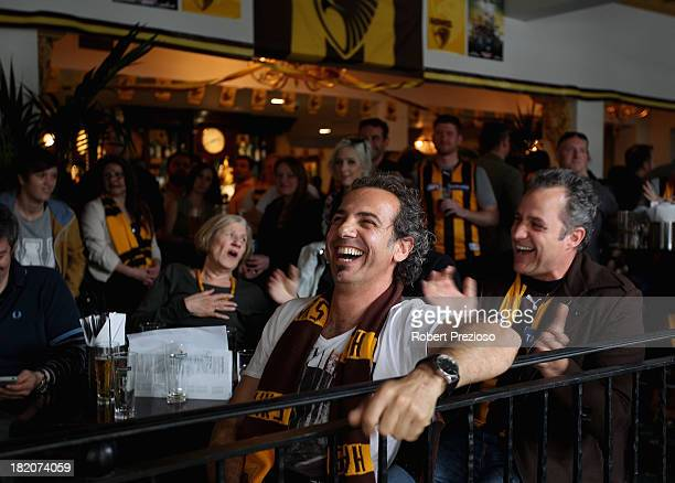 Hawks fans show their support at the Glenferrie Hotel in Hawthorn watching the 2013 AFL Grand Final match between the Hawthorn Hawks and the...