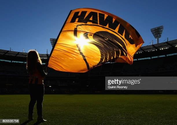 A hawks flag is waved during the round 15 AFL match between the Hawthorn Hawks and the Collingwood Magpies at Melbourne Cricket Ground on July 2 2017...