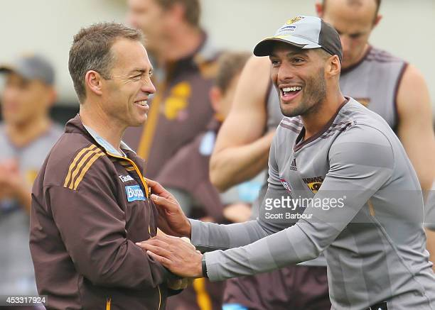 Hawks Head Coach Alastair Clarkson and Josh Gibson laugh during a Hawthorn Hawks AFL training session at Waverley Park on August 8 2014 in Melbourne...