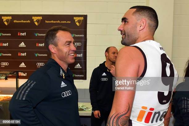 Hawks head coach Alastair Clarkson chats with Shaun Burgoyne of the Hawks after the round 14 AFL match between the Adelaide Crows and the Hawthorn...