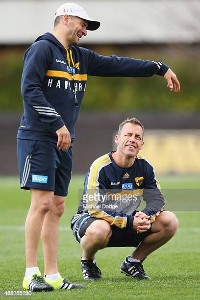 Hawks head coach Alastair Clarkson looks at assistant coach Adam Yze gesture during a Hawthorn Hawks AFL training session at Waverley Park on...