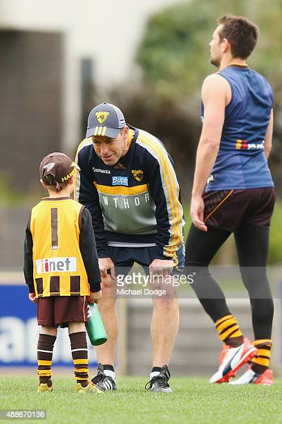 Hawks head coach Alastair Clarkson talks to a young fan during a Hawthorn Hawks AFL training session at Waverley Park on September 17 2015 in...