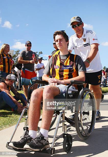 Hawks head coach Alastair Clarkson wheels a fam through the crowd and onto the ground for the warm up during the 2016 AFL NAB Challenge match between...