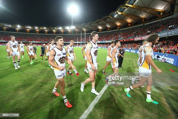 Hawks leave the field after losing the round three AFL match between the Gold Coast Suns and the Hawthorn Hawks at Metricon Stadium on April 9 2017...