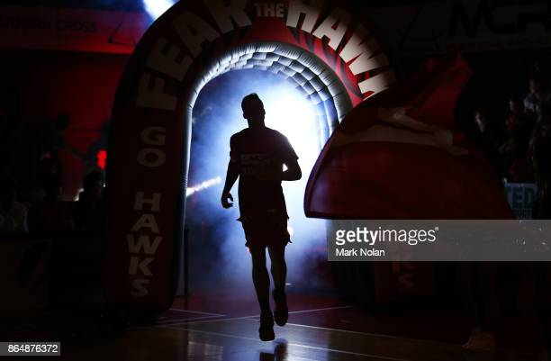 Hawks player runs onto the court before the round three NBL match between the Illawarra Hawks and the Brisbane Bullets at Wollongong Entertainment...
