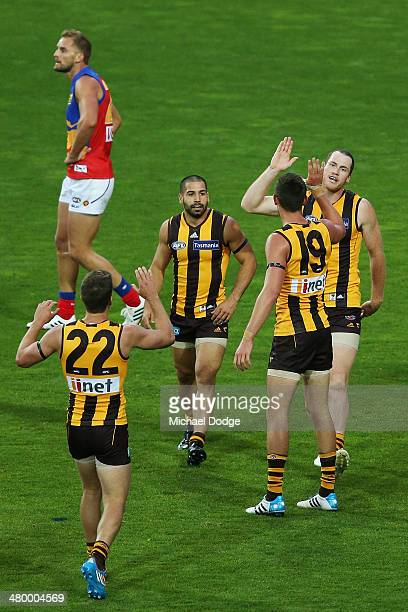Hawks players celebrate a goal by Jarryd Roughead during the round one AFL match between the Hawthorn Hawks and the Brisbane Lions at Aurora Stadium...