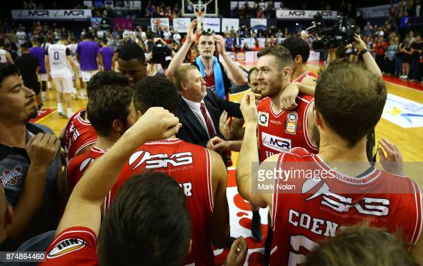 Hawks players celebrate winning the round seven NBL match between the Illawarra Hawks and the Sydney Kings at Wollongong Entertainment Centre on...