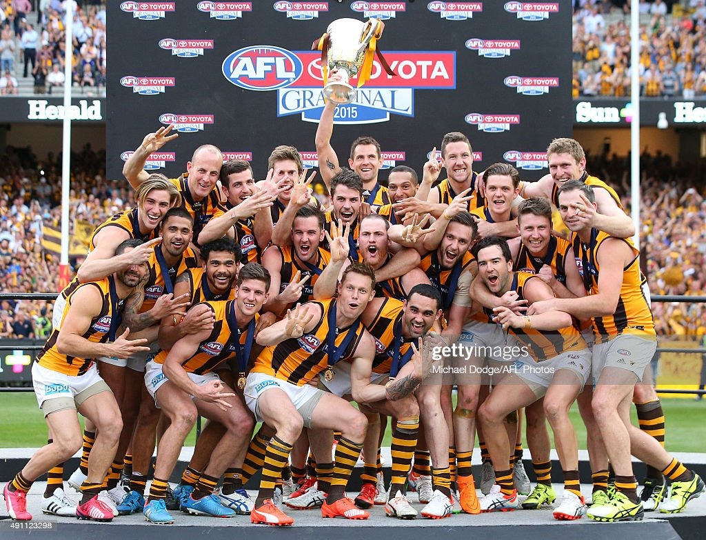 Hawks players celebrates the win during the 2015 AFL Grand Final match between the Hawthorn Hawks and the West Coast Eagles at Melbourne Cricket Ground on October 3, 2015 in Melbourne, Australia.