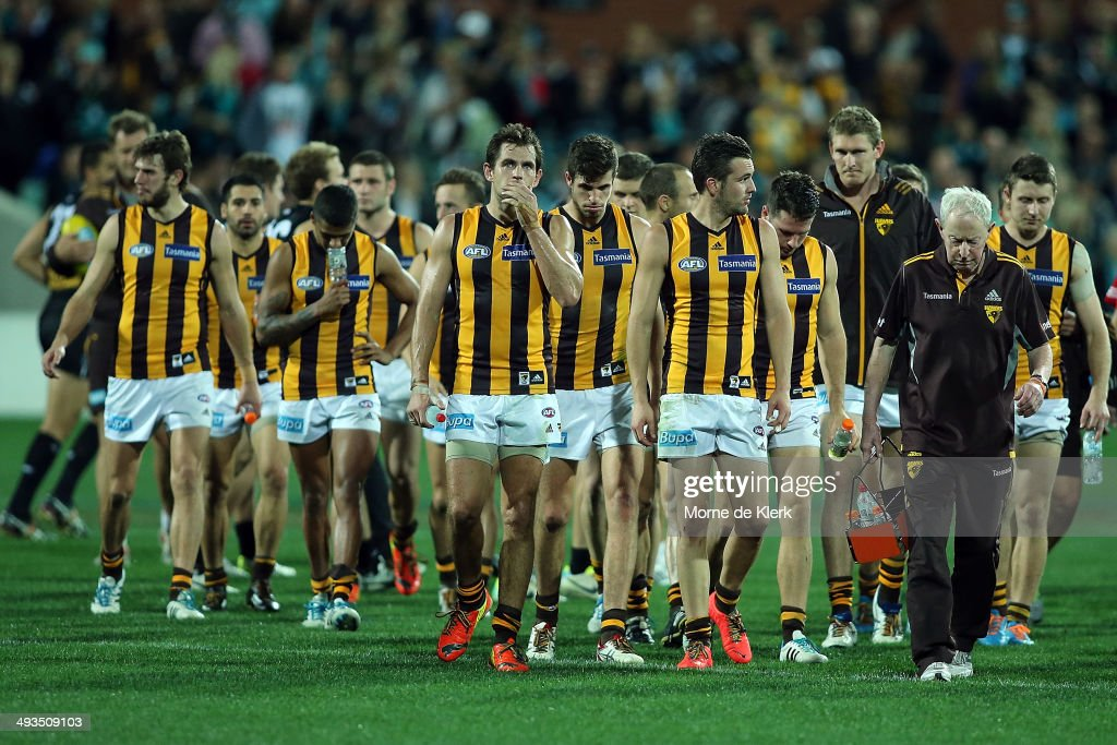 Hawks players leave the field after the round 10 AFL match between the Port Adelaide Power and the Hawthorn Hawks at Adelaide Oval on May 24, 2014 in Adelaide, Australia.