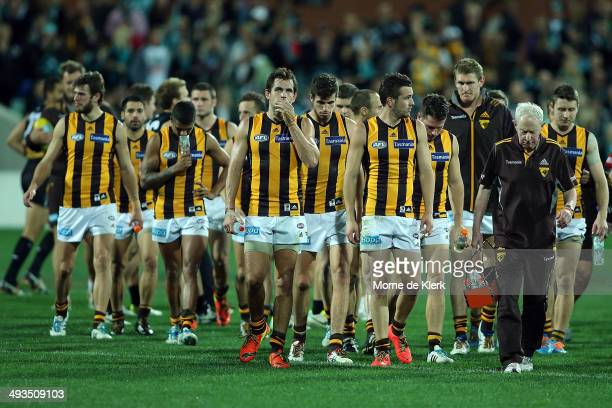 Hawks players leave the field after the round 10 AFL match between the Port Adelaide Power and the Hawthorn Hawks at Adelaide Oval on May 24 2014 in...