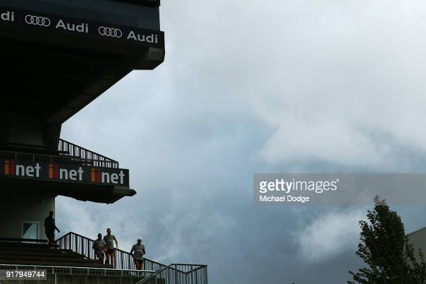 Hawks players walk out as a storm whips through during a Hawthorn Hawks AFL training session on February 14 2018 in Melbourne Australia