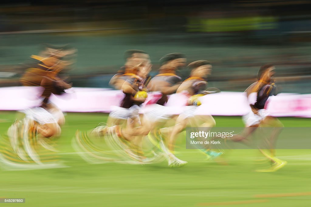 Hawks players warm up before the round 16 AFL match between the Port Adelaide Power and the Hawthorn Hawks at Adelaide Oval on July 7, 2016 in Adelaide, Australia.