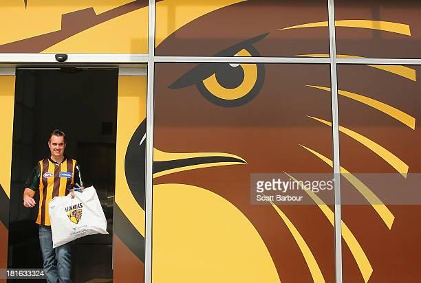 Hawks supporter leaves the HawksNest merchandise store after purchasing Hawks gear on September 23 2013 in Melbourne Australia The Hawthorn Hawks...