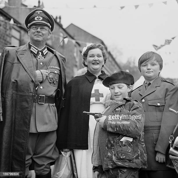 CONTENT] Haworth village 1940s vintage weekend A family are dressed in vintage world war two costumesA German Officer a British nurse and two...