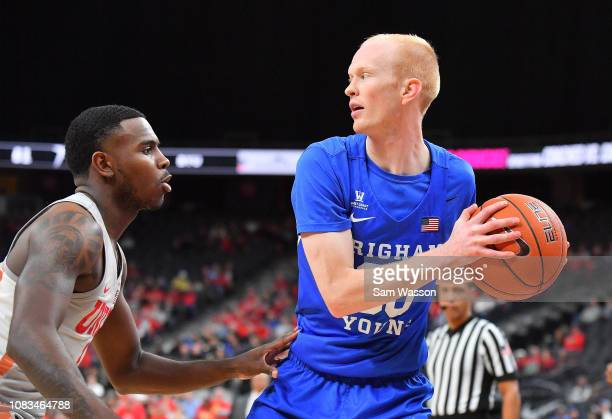 Haws of the Brigham Young Cougars looks to drive against Amauri Hardy of the UNLV Rebels during their game at TMobile Arena on December 15 2018 in...