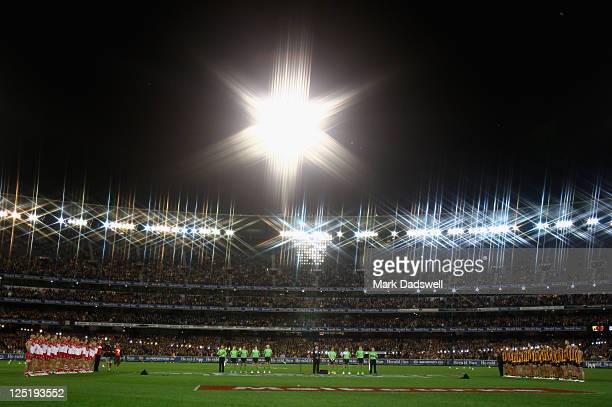 Hawthorn and Sydney line up for the National Anthem during the AFL Second Semi Final match between the Hawthorn Hawks and the Sydney Swans at...