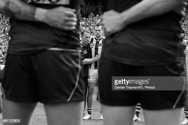 Hawthorn coach Alastair Clarkson and captain Luke Hodge of the Hawks embrace after the national anthem is sung before the 2015 AFL Grand Final match...