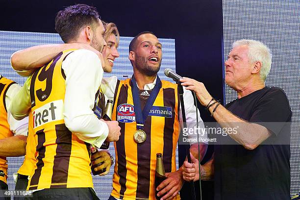 Hawthorn Hawks join Daryl Braithwaite in a performance of Horses during the Hawthorn Hawks AFL Grand Final dinner at Crown Palladium on October 3...