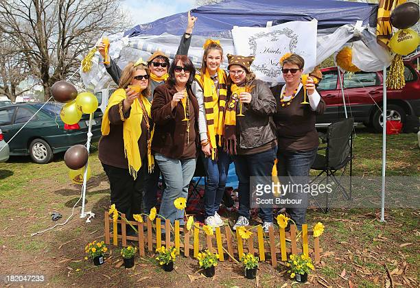 Hawthorn Hawks supporters enjoy a champagne breakfast in the carpark of the 2013 AFL Grand Final match between the Hawthorn Hawks and the Fremantle...