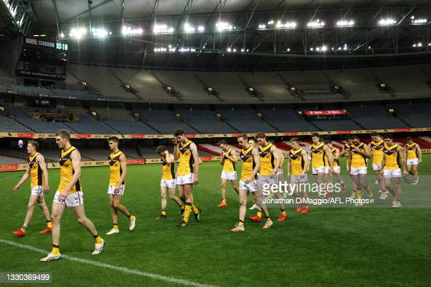 Hawthorn players are seen leaving the arena after their defeat during the round 20 AFL match between Adelaide Crows and Hawthorn Hawks at Marvel...
