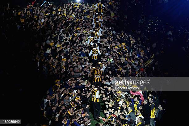 Hawthorn players arrive for the post match AFL Grand Final party at Melbourne Cricket Ground on September 28 2013 in Melbourne Australia