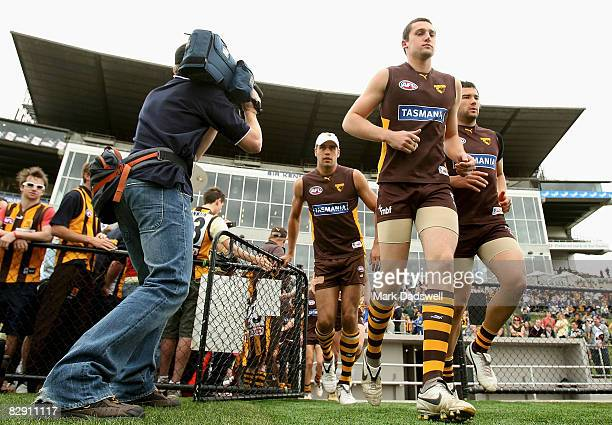 Hawthorn players run on to the ground for the clubs AFL training session at Waverley Park on September 19 2008 in Melbourne Australia