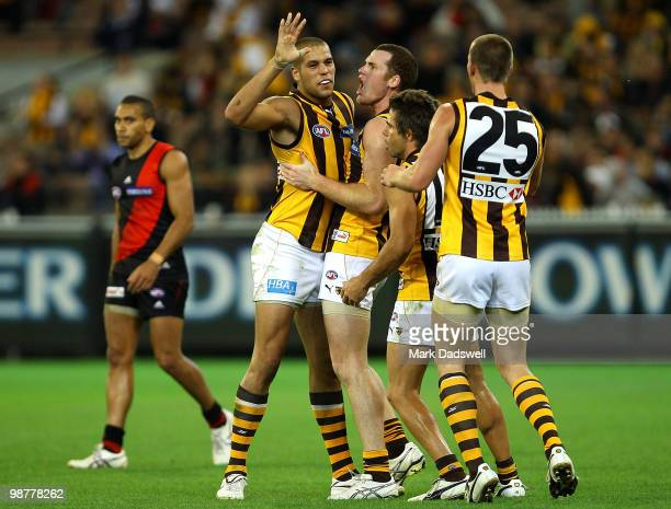 Hawthorn teammates celebrate a Lance Franklin goal during the round 6 AFL match between the Essendon Bombers and the Hawthorn Hawks at Melbourne...