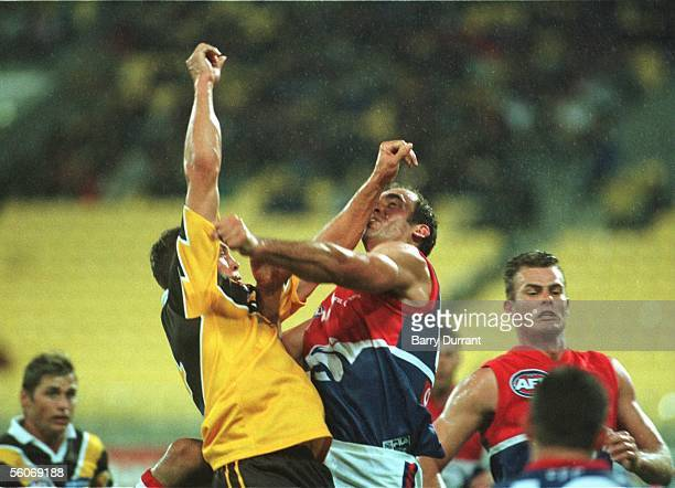 Hawthorn's Richard Taylor jumps against Western Bulldogs Tony Liberatore in the wet conditions during the AFL game played at the WestpacTrust Stadium...