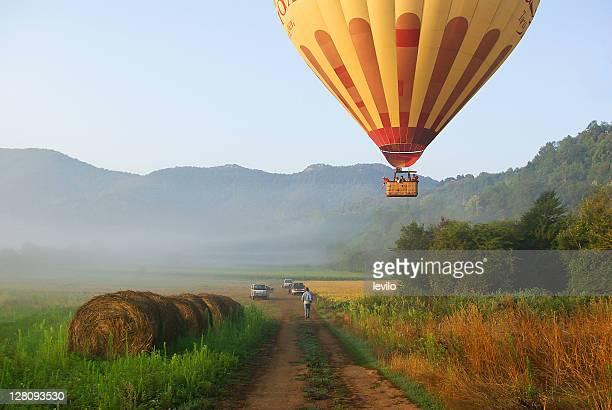 Hay bale and hot air balloon