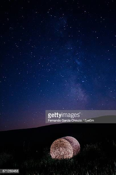 Hay Bale On Field Against Star Field At Night