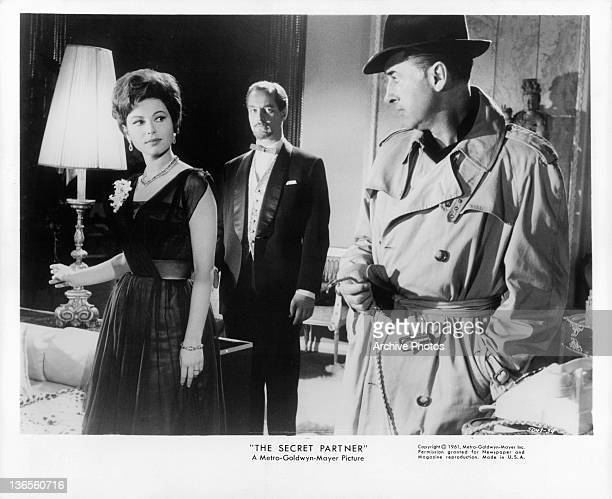 Haya Harareet and Stewart Granger exchange looks in a scene from the film 'The Secret Partner' 1961