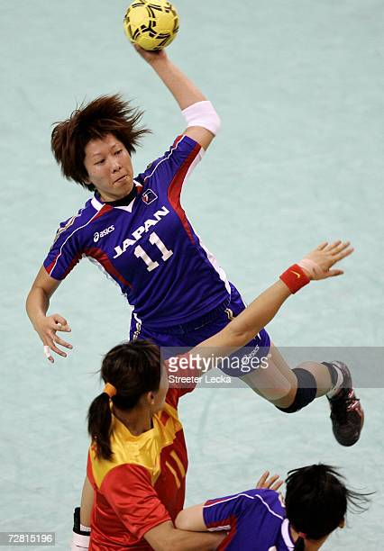 Hayafune Aioko of Japan shoots the ball over Zhang Zhiqing of China in the Women's Handball Bronze Medal Match during the 15th Asian Games Doha 2006...
