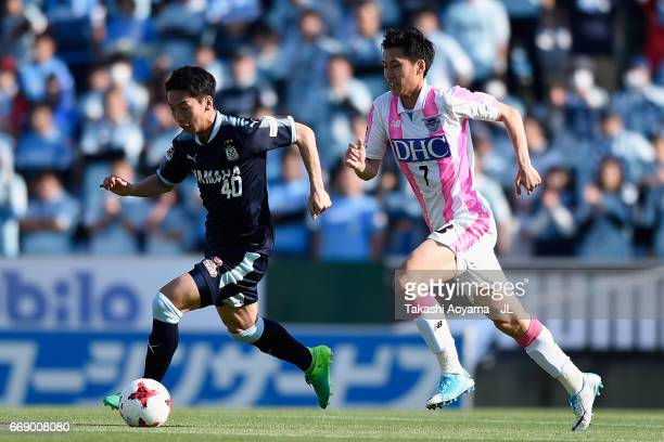 Hayao Kawabe of Jubilo Iwata and Daichi Kamada of Sagan Tosu compete for the ball during the JLeague J1 match between Jubilo Iwata and Sagan Tosu at...