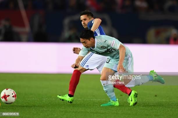 Hayao Kawabe of Jubilo Iwata and Hugo Vieira of Yokohama F.Marinos compete for the ball during the J.League J1 match between Yokohama F.Marinos and...