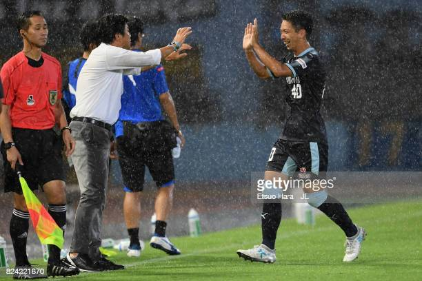 Hayao Kawabe of Jubilo Iwata celebrates scoring the opening goal with head coach Hiroshi Nanami during the JLeague J1 match between Kawasaki Frontale...