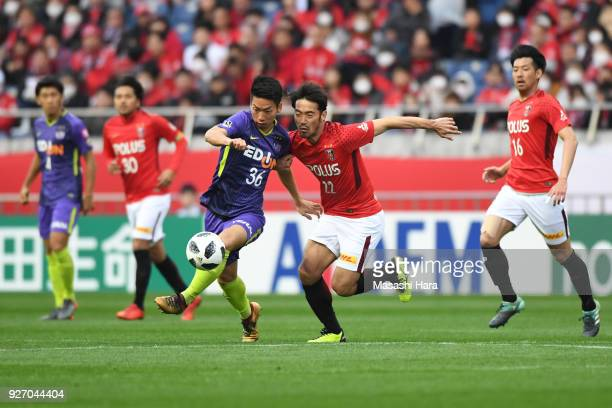 Hayao Kawabe of Sanfrecce Hiroshima and Yuki Abe of Urawa Red Diamonds compete for the ball during the JLeague J1 match between Urawa Red Diamonds...