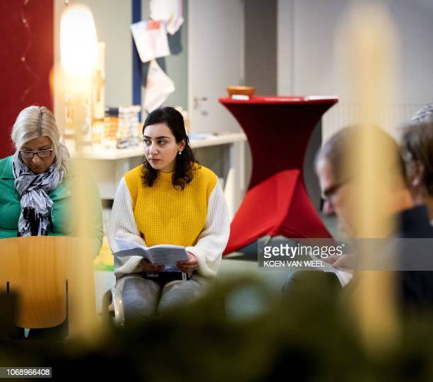 Hayarpi Tamrazyan from Armenia attends a service in the Bethel church in The Hague eastern Netherlands on December 6 as the church is holding...
