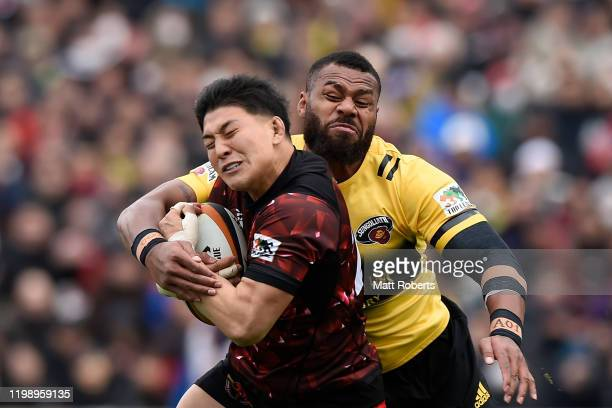 Hayata Nakao of Toshiba Brave Lupus is tackled by Samu Kelevi of Suntory Sungoliath during the Rugby Top League match between Toshiba Brave Lupus and...