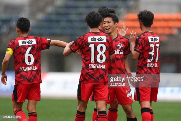 Hayato Asakawa of Roasso Kumamoto celebrates scoring his side's first goal with his team mates during the J.League Meiji Yasuda J3 match between...